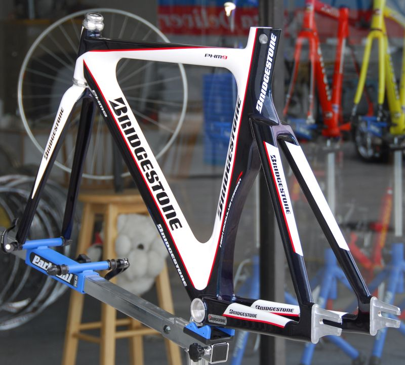 midnight blue metallic/pearl white/red pinstriping - despite descriptions you may find made by vendors that are unfamiliar with these frames, it's not actually black